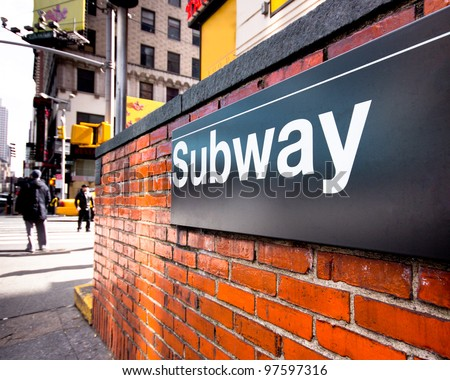 Subway entrance sign at a typical New York City intersection - stock photo
