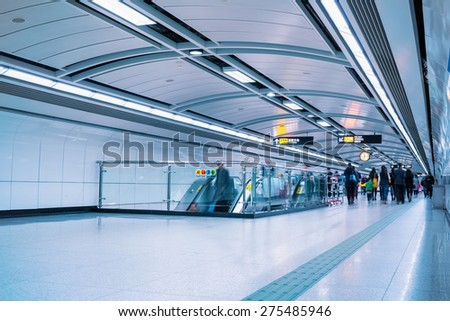 subway passage with passengers motion blur in guangzhou - stock photo