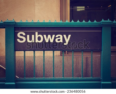 subway sign and entrance with retro instagram filter
