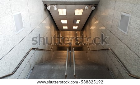 Subway stair with beautiful lighting. Shoot from ground floor.