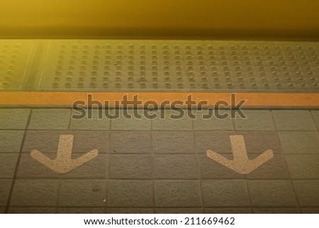 Subway station arrow - stock photo