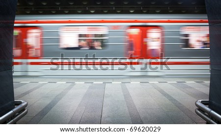 Subway station (motion blurred & color toned image) - stock photo