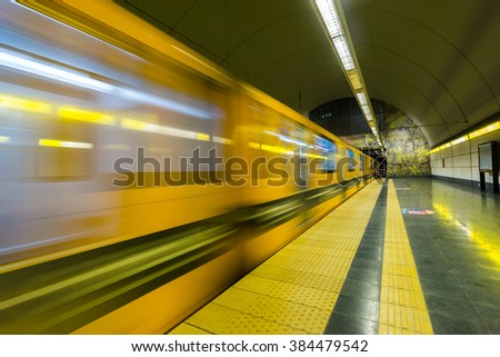Subway train enters station