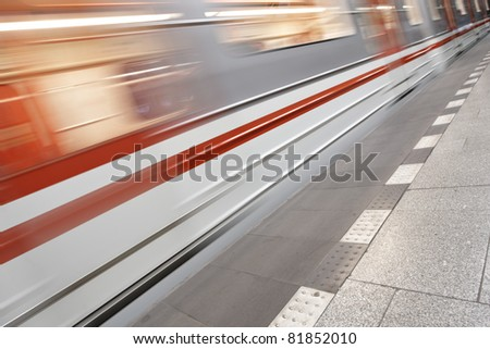 Subway train is arriving in station, Prague - stock photo