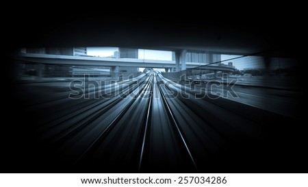 Subway tunnel with blurred light tracks in Dubai, UAE. Modern metro underground transport and connection speed concept. Blue tone image. - stock photo