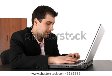 Succesful business man working at laptop isolated on white