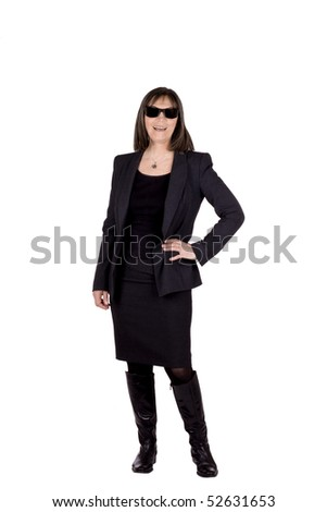 Succesful senior business woma wearing a suit and sun glasses