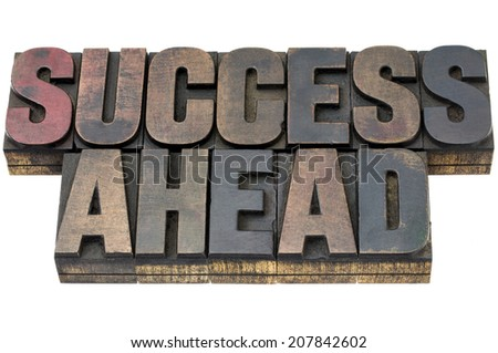 success ahead - isolated words in vintage letterpress wood type with ink patina - stock photo