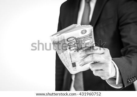Success and got profit from business with businessman holding Euro currency,money in a hand isolated on white background,Focus on number 100 of banknote with black and white color - stock photo