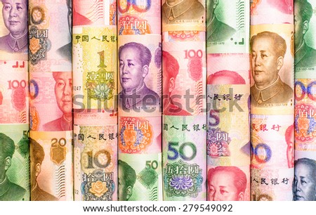 Success and got profit from business with colorful roll of China yuan currency ,money banknote - stock photo