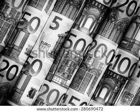 Success and got profit from business with Euro currency,money roll on black and white color - stock photo
