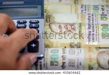 Success and got profit from business with Indian rupee currency,money with calculator,Focus on eye of Gandhi - stock photo