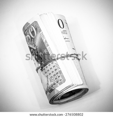Success and got profit from business with roll colorful of English pound currency,money banknote  with black and white color on white background - stock photo