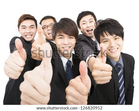 success business team with thumbs up - stock photo