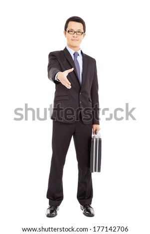 success businessman holding briefcase and handshake - stock photo