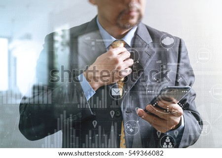 success businessman holding tie and using smart phone,thinking,front view,filter effect,omni channel and business strategy icons interface