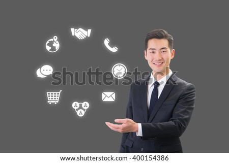 Success businessman showing business icon and chart concept