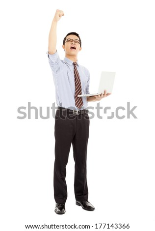 success computer engineer is  standing and raise his hand - stock photo