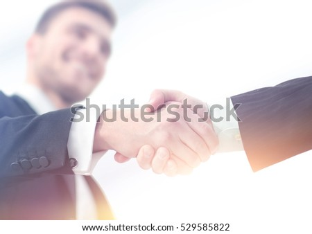 Success concept in business - handshake of  partners
