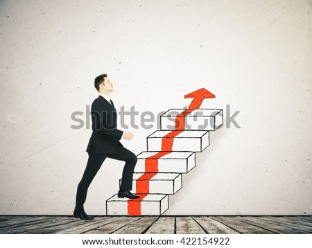 Success concept with businessman climbing ladder and red arrow sketch in room with wooden floor and concrete wall - stock photo