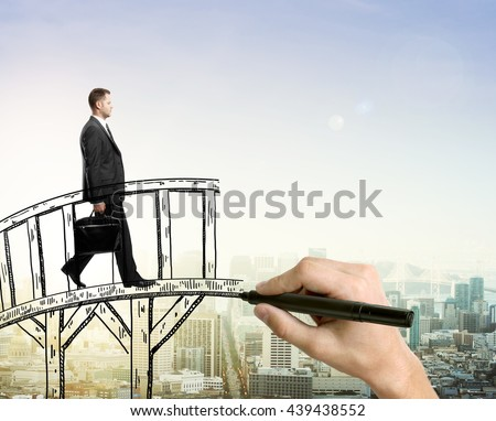 Success concept with hand drawing bridge and businessman walking across it on city background with sunlight