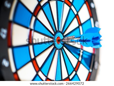 Success: dartboard and darts in bulls-eye - stock photo