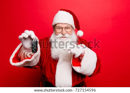 Success, happiness, dream, december, buyer, ownership, property, purchase, rent, sell, truck, cars concept. Funny aged grandfather in red traditional outfit and headwear. X mas noel surprise time!