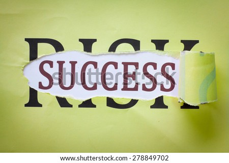 """Success in Risk : The success behind the torn paper written word """"Risk"""". - stock photo"""