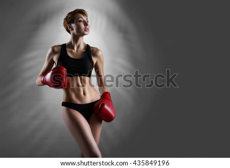 Success is near. Studio portrait of an attractive fierce young woman looking away thoughtfully posing in her sportswear and boxing gloves copyspace on the side - stock photo