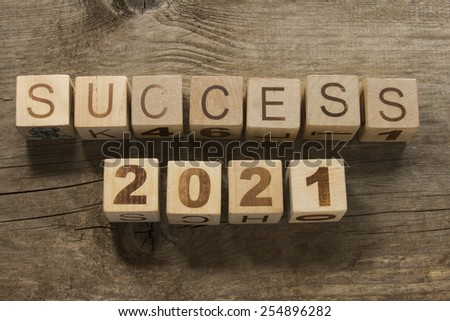 success 2021 on a wooden background - stock photo