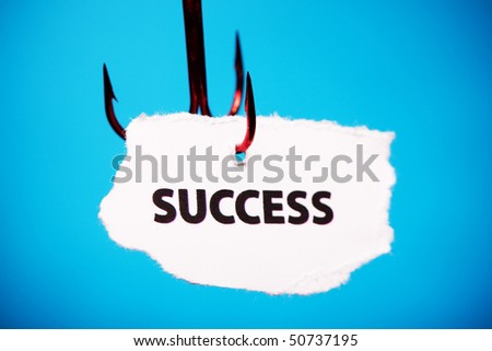Success on piece of paper on hook - stock photo