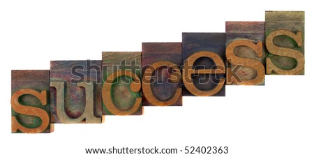 success or growth concept - old letterpress wooden type blocks, stained by colorful inks,  isolated on white - stock photo