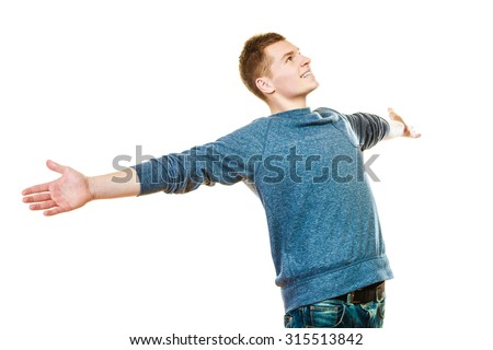 Success positive emotions, happiness freedom. Happy young man successful lad with arms raised looking upwards isolated on white background