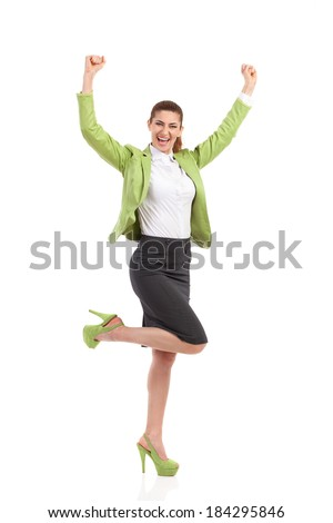 Success. Shouting businesswoman with raised hands. Full length studio shot isolated on white. - stock photo