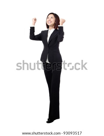 Success / winner business woman isolated. Funny image of celebrating happy young businesswoman in full length with her arms up. - stock photo