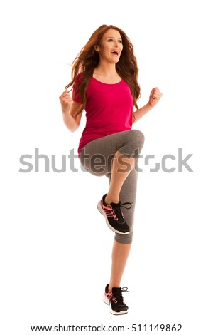 success - woman gesturing victory with her hands raised in the air isolated over white background