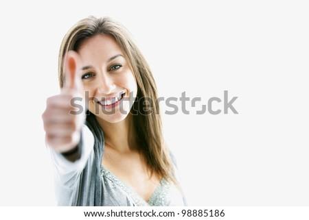 Success woman thumbs up - stock photo