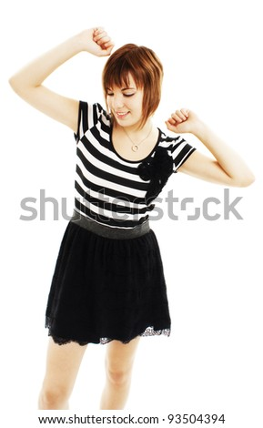 Success young woman dancing and celebrating standing isolated on white background. - stock photo