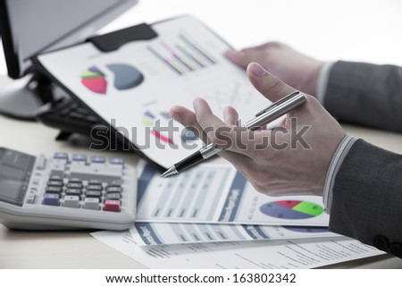Successful accountant working with financial data - stock photo