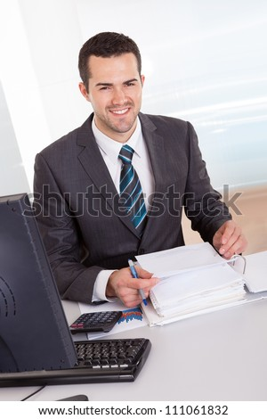 Successful accountant working with financial data in the office - stock photo
