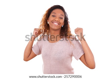 Successful african american woman with clenched fist expressing her joy - Black people - stock photo