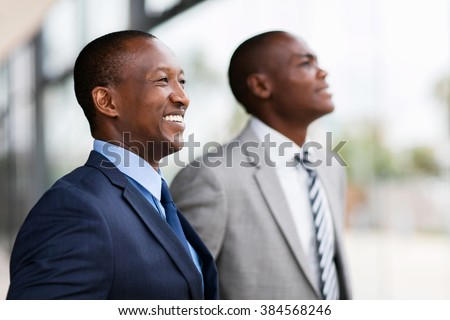 successful african businesspeople looking away - stock photo