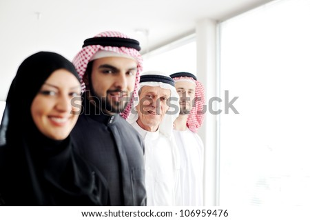 Successful and happy business arabic  people looking at you - stock photo