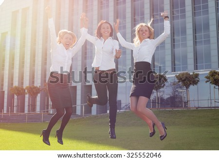 Successful and happy business woman jumping up  - stock photo