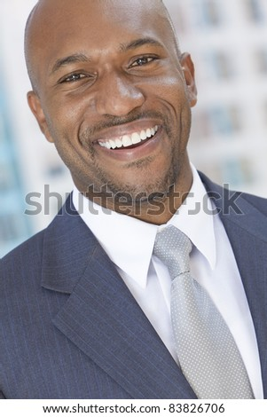 Successful and happy smiling African American businessman or man arms in a modern city - stock photo