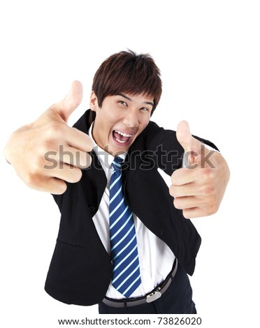 Successful asian young businessman with thumb up - stock photo
