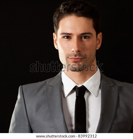 Successful attractive businessman with hand on chin, posing and smiling.Friendly customer support concept. - stock photo