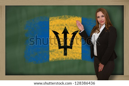 Successful, beautiful and confident woman showing flag of barbados on blackboard for marketing research, presentation and tourist advertising - stock photo