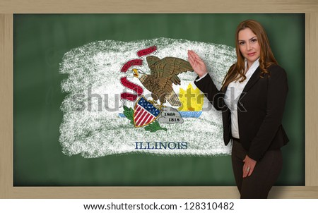 Successful, beautiful and confident woman showing flag of illinois on blackboard for marketing research, presentation and tourist advertising - stock photo