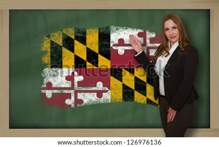 Successful, beautiful and confident woman showing flag of maryland on blackboard for marketing research, presentation and tourist advertising - stock photo